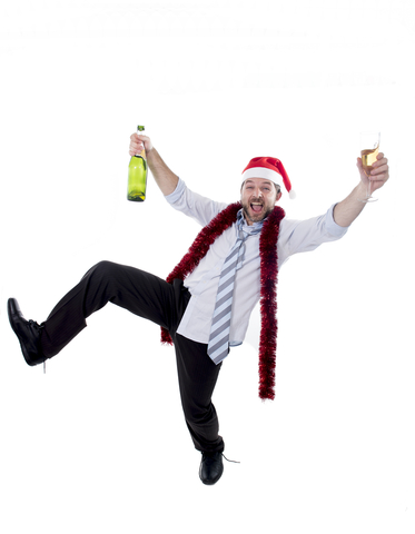 If this photo doesn't sum up the spirit of Christmas, I will give every reader of this blog £100... Copyright Ocusfocus | Dreamstime.com, Drunk businessman dancing and drinking champagne at office Christmas party